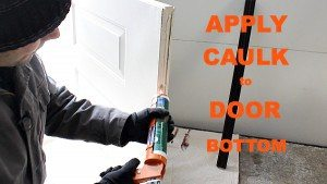 Apply-Caulk-to-Door-Bottom